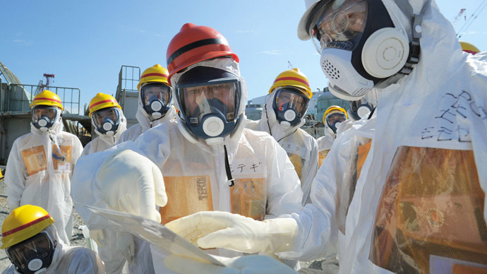 Japan's Economy, Trade and Industry Minister Toshimitsu Motegi (C), wearing a protective suit and a mask, inspects at the tsunami-crippled Fukushima Daiichi nuclear power plant in Fukushima prefecture August 26, 2013, in this photo released by Kyodo. (Reuters/Kyodo)