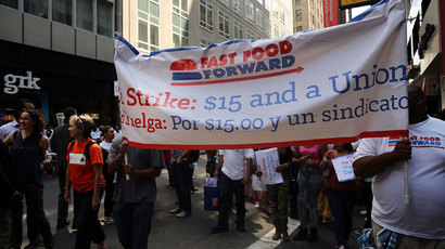 Employees and supporters demonstrate outside of a Wendy's and Burger King fast-food restaurants to demand higher pay and the right to form a union on August 29, 2013 in New York City.(AFP Photo / Spencer Platt)