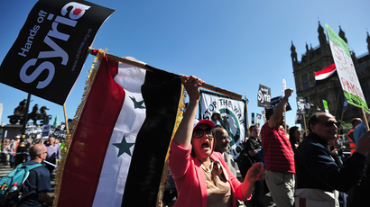 Protesters shout slogans and wave the Syrian flag as they demonstrate against military intervention in Syria in central London on August 31, 2013 (AFP Photo / Carl Court)