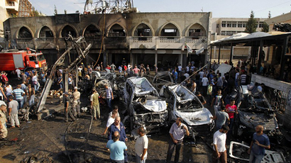 Lebanese civilians gather next to the site of a blast outside the Al-Taqwamosque in the northern city of Tripoli on August 23, 2013. (AFP Photo / Anwar Amro)