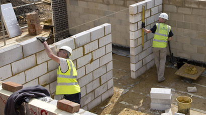 Construction workers build a new residential property development in north London, August 6, 2013. (Reuters/Neil Hall)