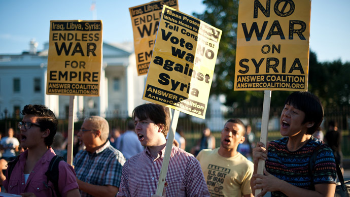 People demonstrate against US intervention in Syria in front of the White House in Washington on September 3, 2013. (AFP Photo/Nicholas Kamm)
