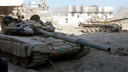Syrian army tanks are seen deployed in the Jobar neighbourhood of Damascus (AFP Photo)
