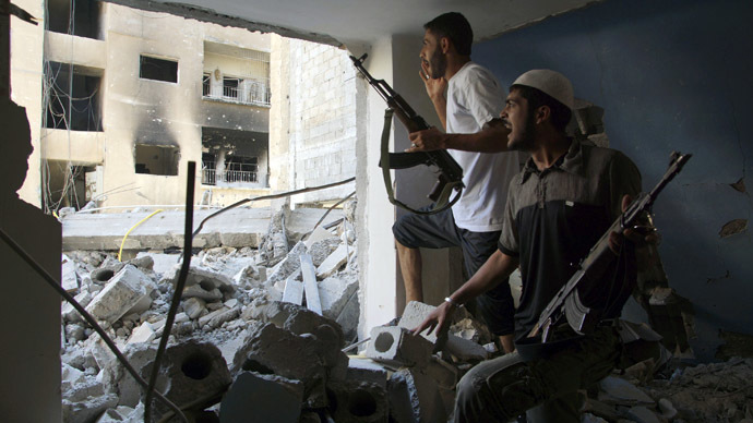 Free Syrian Army fighters shout as they take cover inside a damaged house in Deir al-Zor August 19, 2013.  (Reuters/Khalil Ashawi)