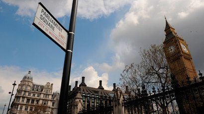 Street signs are seen near the Houses of Parliament in London.(Reuters / Toby Melville)