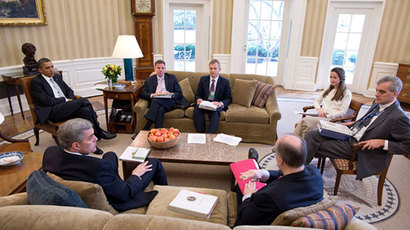 U.S. President Barack Obama (L) meets with National Security staff in the Oval Office in this White House photograph taken on March 8, 2012 and obtained on June 13, 2013.(Reuters / Pete Souza)