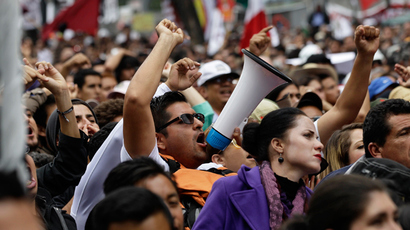 Thousands of followers listen to Mexican leftist Andres Manuel Lopez Obrador (not pictured) during a political gathering in Mexico City September 8, 2013 (Reuters / Henry Romero)
