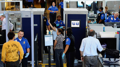 Transportation Security Administration (TSA) agents screen passangers at Los Angeles International Airport.(AFP Photo / Kevork Djansezian)
