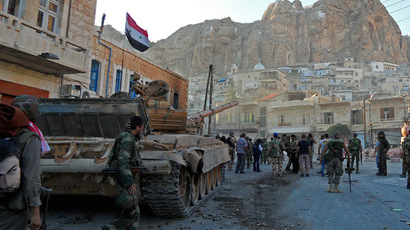 Syrian pro-government troops are seen on the streets of the Christian town of Maaloula on September 11, 2013. (AFP Photo)