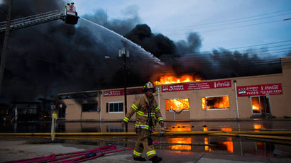 New Jersey firefighters spray water at a burning building as they work to control a massive fire in Seaside Park in New Jersey September 12, 2013.(Reuters / Eduardo Munoz)