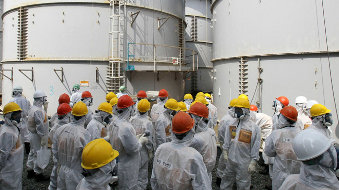 Members of a Fukushima prefecture panel, which monitors the safe decommissioning of the nuclear plant, inspect a contaminated water tank (C, in the back) which leaked radioactive water at the H4 area of the contaminated water storage tanks, at Tokyo Electric Power Co. (TEPCO)'s tsunami-crippled Fukushima Daiichi nuclear power plant in Fukushima in this September 13, 2013, photo released by Kyodo.  (Reuters/Kyodo)