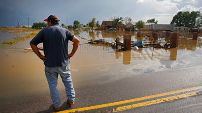 Manuel Sanchez takes in the view of his flooded home and property on September 14, 2013 in La Salle, Colorado (AFP Photo /  Marc Piscotty)