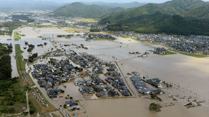 An aerial view shows residential areas flooded by the Yura river after tropical storm Man-yi, also known locally as Typhoon No.18, hit in Fukuchiyama, Kyoto prefecture, in this photo taken by Kyodo September 16, 2013.(Reuters / Kyodo)