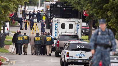 Police walk in the Washington Navy Yard after a shooting in Washington on September 16, 2013 (Reuters / Joshua Roberts)