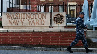 A member of the military arrives for work at the front gate of the Washington Naval Yard September 17, 2013 in Washington, DC. (AFP Photo / Mark Wilson)