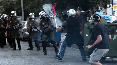 Greek demonstrators clash with riot police in Athens on September 18, 2013. (AFP Photo / Aris Messinis)