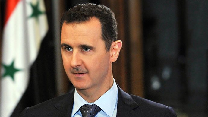 Assad vows to destroy chemical weapons within about a year
