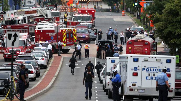 Emergency vehicles and law enforcement personnel respond to a reported shooting at an entrance to the Washington Navy Yard September 16, 2013 in Washington, DC. (AFP Photo / Alex Wong)
