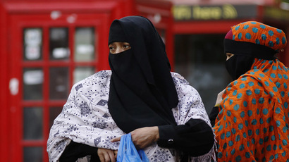 Women wears a full-face veil as they shop in London September 16, 2013. (Reuters/Luke MacGregor)