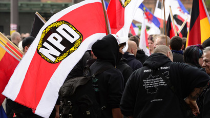 Supporters of Germany's right extremist National Democratic Party (NPD) wave flags as they take part in a neonazi demonstration on May 1, 2013 in Berlin. (AFP Photo/John Macdougall)
