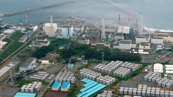 An aerial view shows Tokyo Electric Power Co. (TEPCO)'s tsunami-crippled Fukushima Daiichi nuclear power plant and its contaminated water storage tanks (bottom) in Fukushima, in this photo taken by Kyodo August 20, 2013.(Reuters / Kyodo)
