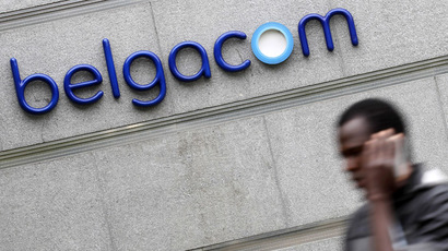 A man walks past the Belgacom Tower, the headquarters of Belgium's dominant telecom operator Belgacom, in Brussels (Reutews/Yves Herman)