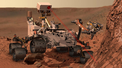 This artist's concept depicts the rover Curiosity, of NASA's Mars Science Laboratory mission, as it uses its Chemistry and Camera (ChemCam) instrument to investigate the composition of a rock surface. (Reuters/NASA/JPL-Caltech)