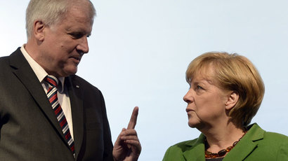 German Chancellor Angela Merkel (R) and chairman of the Christian Social Union of Bavaria (CSU), Horst Seehofer attend an election campaign event of her German Christian Democratic Union (CDU) party in the southern German town of Munich on September 20, 2013.(AFP Photo / Christof Stache)