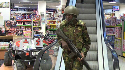 An image grab taken from AFP TV shows military forces taking position inside a shopping mall following an attack by masked gunmen in Nairobi on September 21, 2013. (AFP Photo / Nichole Sobecki)