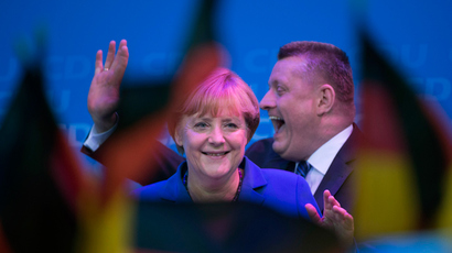 German Chancellor Angela Merkel and CDU secretary general Hermann Groehe celebrate at the Christian Democratic Union (CDU) party's headquarters in Berlin on September 22, 2013, after the German general elections (AFP Photo)