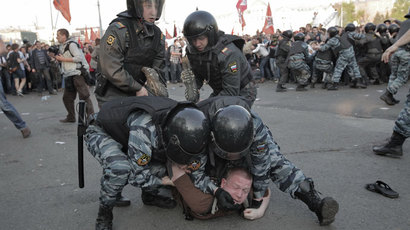 Police detain participants of the March of Millions protest rally on Moscow's Bolotnaya Square.(RIA Novosti / Andrey Stenin)