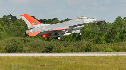 A QF-16 full scale aerial target from the 82nd Aerial Targets Squadron takes off on its first unmanned flight at Tyndall Air Force Base, Fla. Sept. 19, 2013. The 82nd ATRS operates the Department of Defense's only full-scale aerial target program. The QF-16 will provide a fourth generation fighter representation of real world threats. (U.S. Air Force photo/Staff Sgt. Javier Cruz)