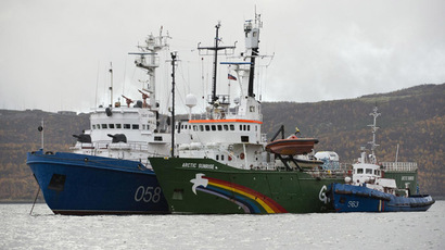 This handout picture released on September 28, 2013 by Greenpeace International shows the Greenpeace International ship, Arctic Sunrise (C), in Murmansk harbour. Greenpeace on September 27, 2013 vowed to appeal and not give in to intimidation after a Russian court ruled to detain all 30 crew members of a ship involved in a high seas protest against Arctic oil drilling. (AFP Photo/Dmitri Sharomov)