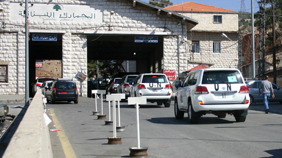 A convoy of United Nations vehicles is seen at the Lebanon-Syria Masnaa border crossing on October 1, 2013 as a chemical weapons disarmament team cross into Syria to begin the daunting task of inventorying the country's arsenal of the banned weapons in readiness for its destruction (AFP Photo / Louai Beshara)