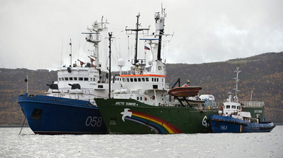 This handout picture released on September 28, 2013 by Greenpeace International shows the Greenpeace International ship, Arctic Sunrise (C), in Murmansk harbour. (AFP Photo / Dmitriy Sharomov)
