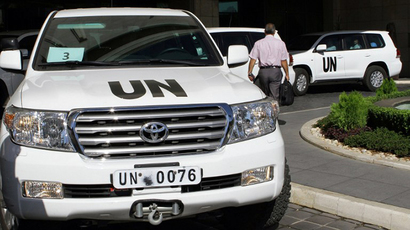 United Nations vehicles are seen leaving the hotel in Damascus on October 3, 2013. (AFP Photo / Louai Beshara)