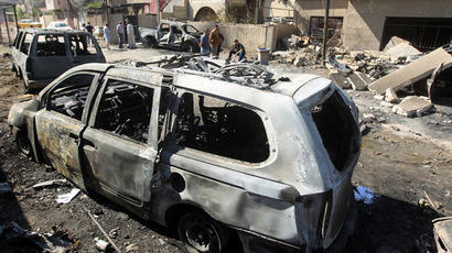 Iraqis inspect the aftermath of a suicide attack in Baghdad's eastern al-Jadidah district, on October 7, 2013. (AFP Photo)