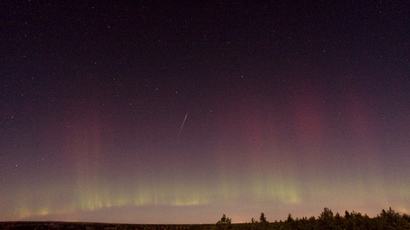 View of a shooting star (Draconid) and northern light near Skekarsbo, Sweden (AFP Photo Scanpix P-M Heden)
