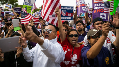 The crowd cheers during a rally in support of immigration reform, in Washington, on October 8, 2013 in Washington, DC (Drew Angerer/ Getty Images / AFP)