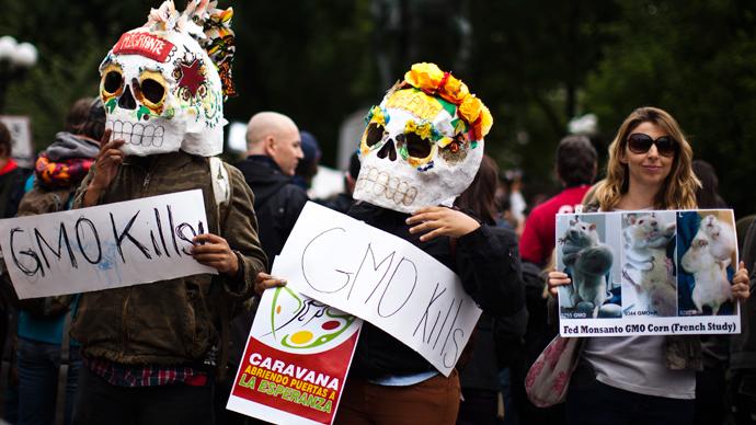 Anti-Monsanto protesters dump bags of cash in Senate building