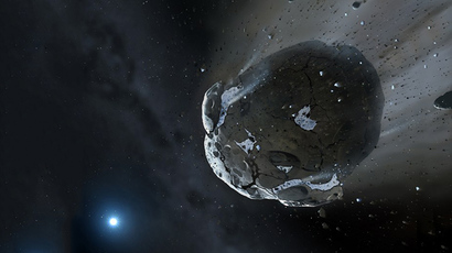 This is an artist impression obtained from The University of Warwick and The University of Cambridge shows a rocky and water-rich asteroid being torn apart by the strong gravity of the white dwarf star GD 61. (AFP Photo)