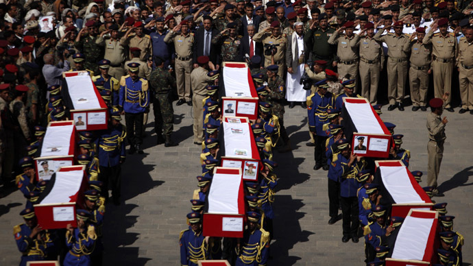 Honour guards carry the coffins of soldiers and policemen killed in recent attacks during a funeral procession in Sanaa September 22, 2013. (Reuters/Khaled Abdullah)