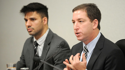 The Guardian's Brazil-based reporter Glenn Greenwald (R), who was among the first to reveal Washington's vast electronic surveillance program, accompanied by his partner David Miranda, testifies before the investigative committee of the Senate that examines charges of espionage by the United States in Brasilia on October 9, 2013, following press reports of US electronic surveillance in Brazil based on leaks from Edward Snowden, a former US National Security Agency contractor. (AFP Photo/Evaristo Sa)