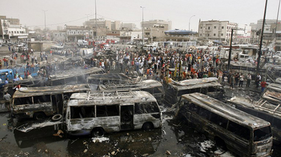 Iraqis gather at the site of a car bomb explosion in Baghdad's al-Sadriyah neighborhood, 18 April 2007, in which over a hundred people were killed. (AFP Photo / Ahmad al-Rubaye)