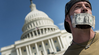 John Zangas, a furloughed worker, protests the government shutdown on Capitol Hill on October 2, 2013 in Washington, DC. (AFP Photo / Brendan Smialowski)