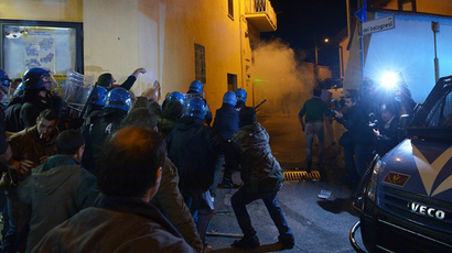 Protesters and far-right activists clash as Catholic rebels try to hold funeral of Nazi war criminal Erich Priebke in Albano Laziale near Rome on October 15, 2013. (AFP Photo / Vincenzo Pinto)