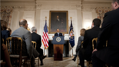 US President Barack Obama speaks about the reopening of government following a shutdown in the State Dining Room of the White House in Washington, DC, October 17, 2013 (AFP Photo / Saul Loeb)