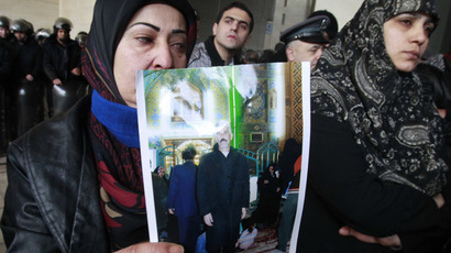 Relatives of Lebanese Shiite pilgrims kidnapped last May in Syria show pictures during a protest in front of the Qatari embassy in Beirut on January 10, 2013.  (AFP Photo)