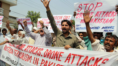 Pakistani protesters belonging to a United Citizen Action group hold a banner as they shout anti-US slogans during a protest in Multan on September 30, 2013, against US drone attacks in Pakistani tribal areas. (AFP Photo/S.S. Mirza)