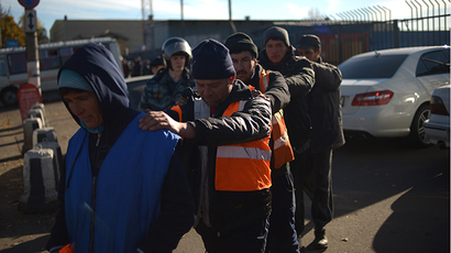Migrants detained during a raid in Moscow. (RIA Novosti / Grigoriy Sisoev)